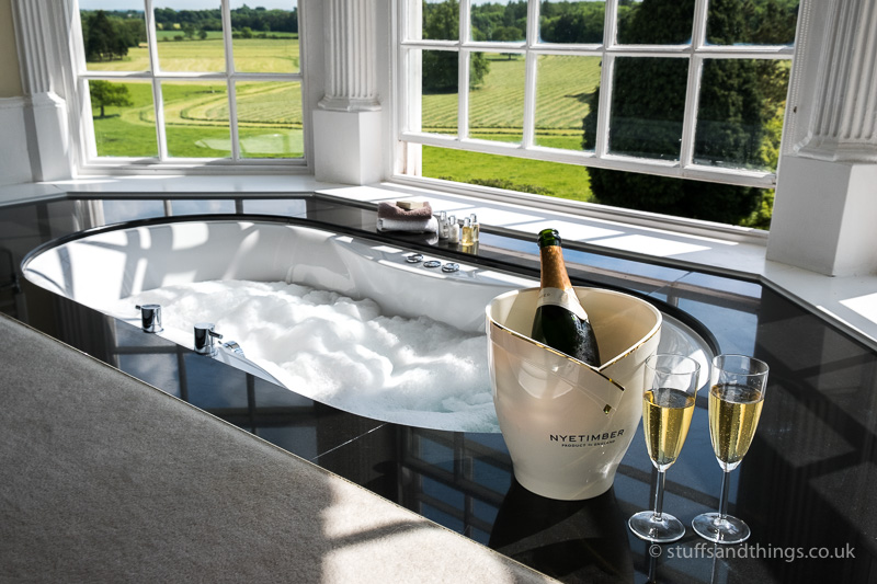 Enjoying a bottle of Nyetimber sparkling wine in the bath
