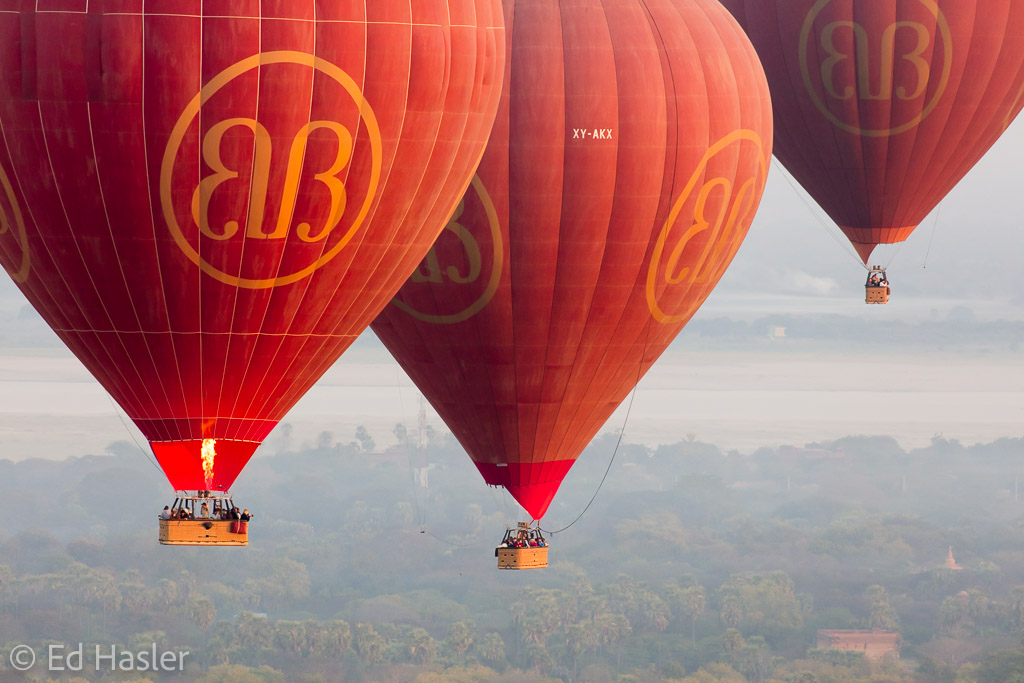 Three balloons floating above Bagan